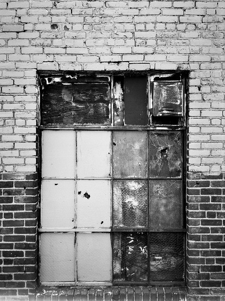 Old windows in a New York warehouse are closed up and painted over which creates a nice textured background. (Scanned from black and white film.)