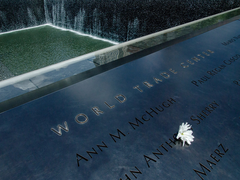 NEW YORK, NY - JUNE 24, 2012:  The 9/11 Memorial commemorates the September 11, 2011 attack on the World Trade Center in New York as seen on June 24, 2011 in New York City. The memorial is centered around a large water fountain and includes names to memorialize all of the victims.