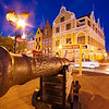 Evening shot of a cannon with Dutch architecture in Punda, Willemstad, Curacao, Netherlands Antillies