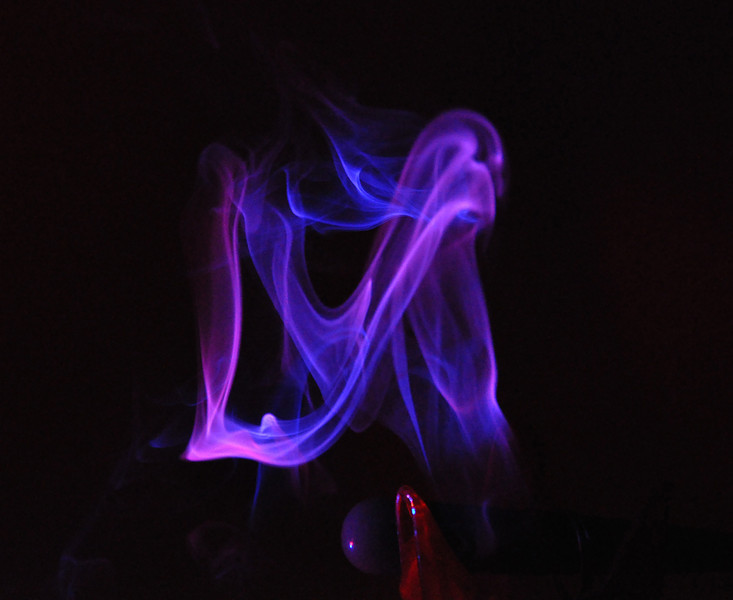 In this smoke picture, you can see the letters L & V in the smoke. An assistant held a light to the side to give the smoke the color.
