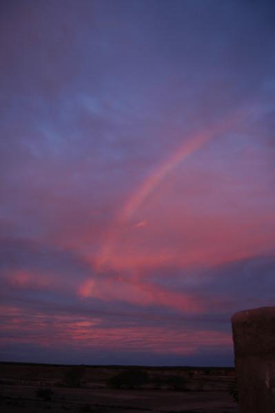 a rainbow at sunset