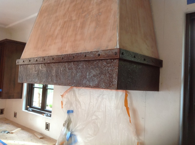 Hammered copper accent on stove hood - Carie residence, La Canada, CA