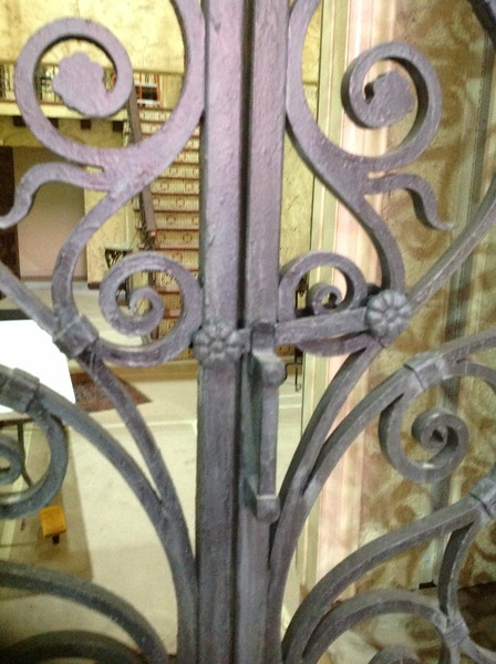 "Detail of baby Jane's wrought iron entry doors on the set of ""Fued"""