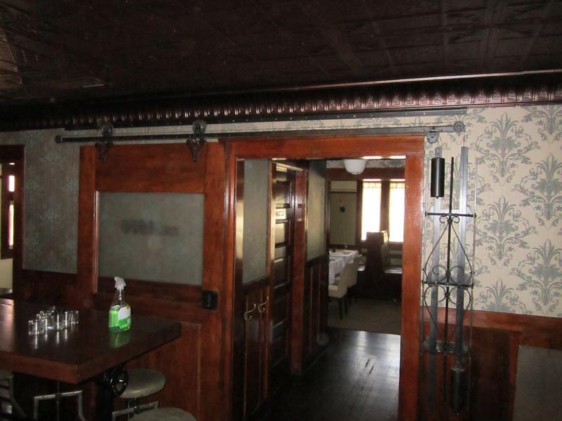 Blackened steel rolling door hardware - Raymond Restaurant, Pasadena, CA