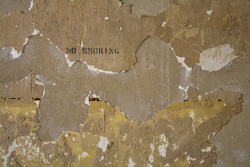 "Detail of wall with ""NO SMOKING"" stencil in original 1908 hospital building on the South Side of Ellis Island."