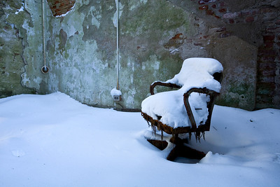 Snow having fallen upon a chair in a patient room in the Kirkbride building at Greystone Park State Hospital.  This chair has since disintegrated in the building that had the largest continuous foundation until the construction of the Pentagon.