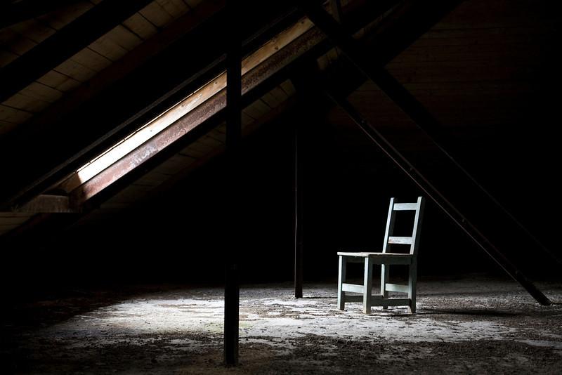 Chair underneath a dormer window in Stedman Hall's attic.  Norwich State Hospital.