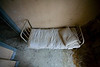 "Patient bed in Salmon Hall, the forensic building for men at Norwich State Hospital.  Forensic patients are those deemed ""Not Guilty by Reason of Insanity""."