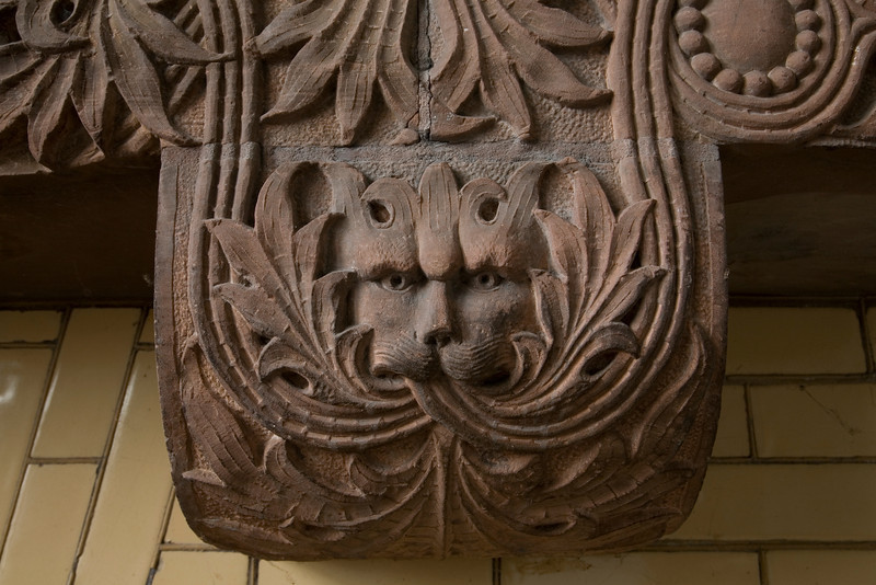 """Detail of """"Green Beast"""" mantle over fireplace in Sandstone Wards, Buffalo State Hospital."""