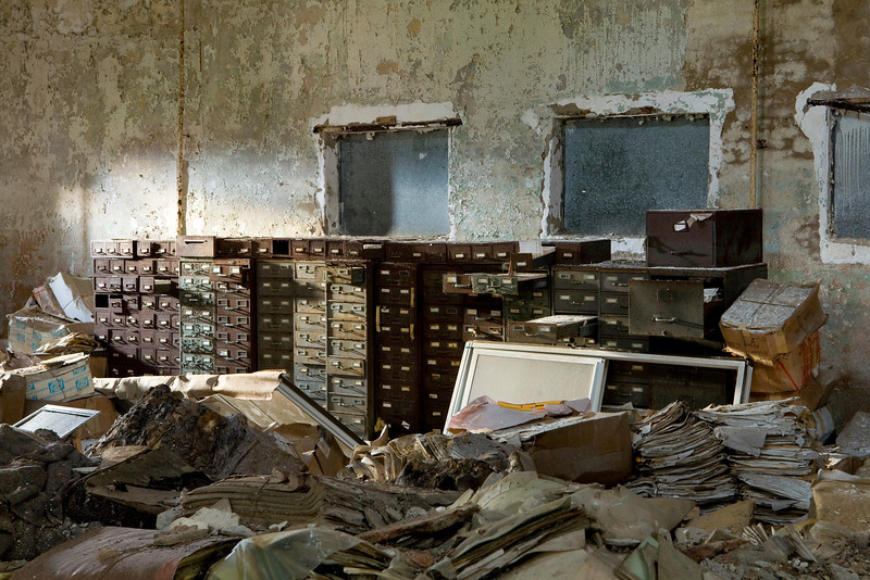 NYC Department of Corrections records rotting away in a small building on Hart Island.  The majority of the island serves as the public graveyard for the city; over 800,000 bodies lie out there.
