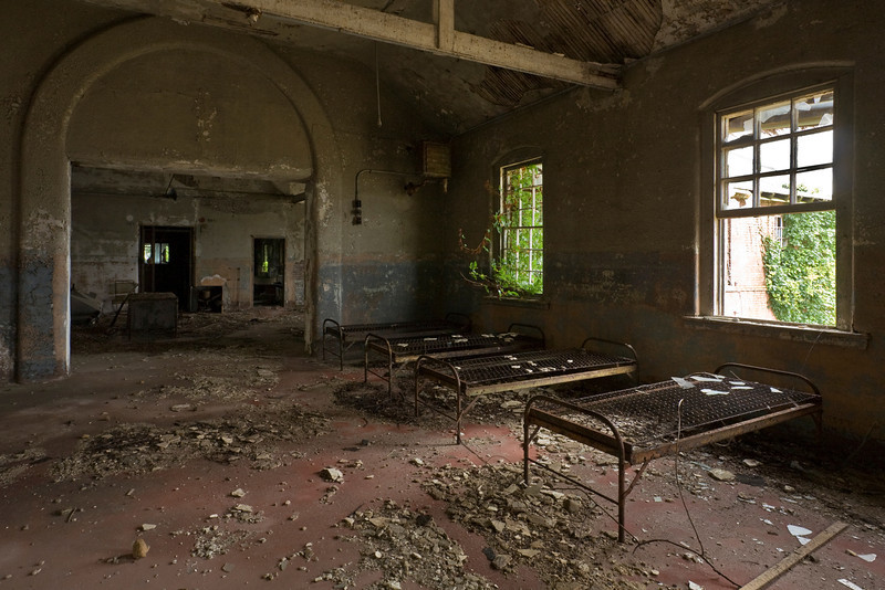 "Bedframes on the ward of the ""White Dove"" building, originally part of the women's insane asylum.  Hart Island, New York City."