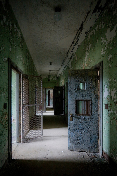 Heavy seclusion door in Salmon Hall, the male forensic (criminally insane) building at Norwich State Hospital.  This site has since been demolished.