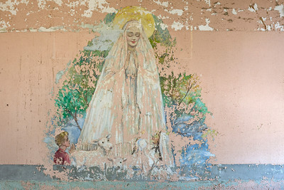 Patient mural depicting the Virgin Mary uncovered with steel wool on the fourth floor of Building 25, Creedmoor State Hospital.