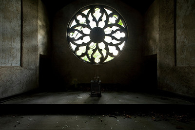 Rose window in the Catholic chapel on Hart Island, most of which serves as New York City's Potter's Field.  Curiously, there was a milk crate in front of the window upon which sat two unexploded grenades.