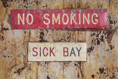 Signs on fourth-floor Sick Bay door, Building 25, Creedmoor State Hospital.