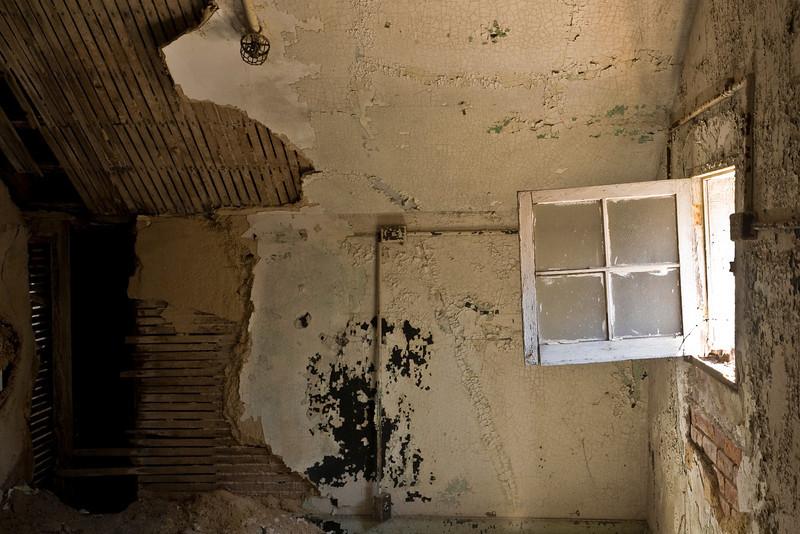 Tiny window having fallen open in small top-floor room, Fort Totten Army Hospital.