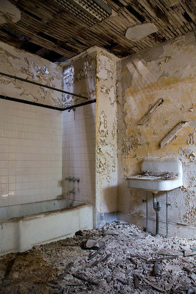 Fourth-floor bathroom in Male Wards of Hudson River State Hospital.  Originally, this floor would have housed staff; when the hospital became overcrowded, it would have been repurposed for patients.  This part of the building is no longer accessible due to collapse.