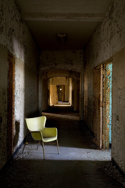 Faux Eames chair in the hallway of Building 25, Creedmoor State Hospital.
