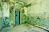 Seclusion room with significant algae growth, Walker Building, Central State Hospital.