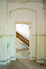 Staircase in the administrative central portion of Willard State Hospital's Maples Building, an 1872 linear (Kirkbride) influenced asylum structure.