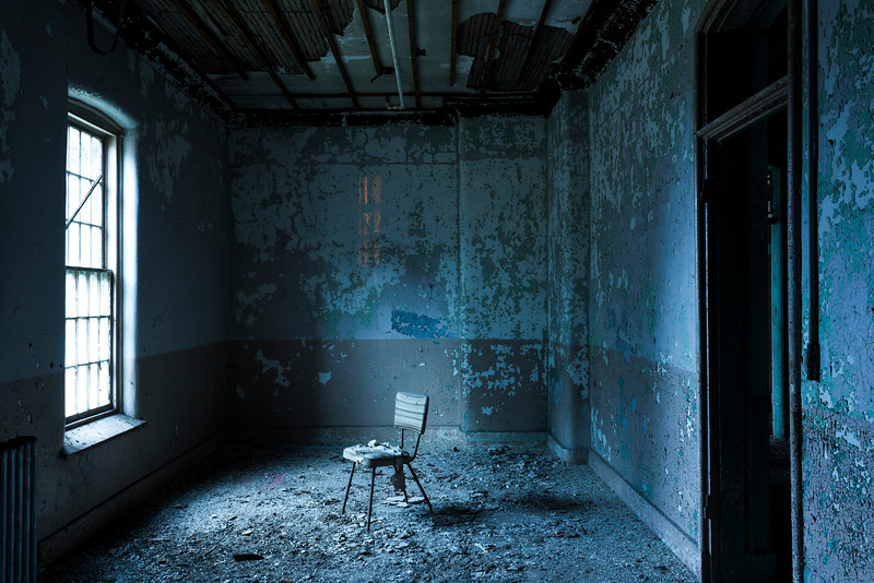 """Lonely chair"" in patient room during civil twilight, Maples Building, Willard State Hospital.  The first of four miniature Kirkbride buildings on the campus, it is surprisingly also in the best condition of the three remaining in abandonment."
