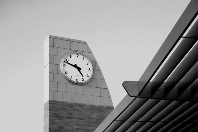 Modern clock with a bold, clear sky.