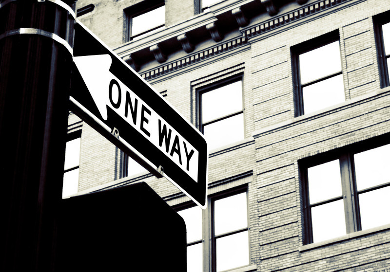 One way sign in black and white. High key for drama.