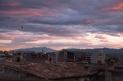 Sunset overlooking the clay tile rooftops of Girona.