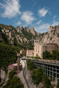 The Montserrat buildings, Cathedral and Monastery site just a short drive outside of Barcelona, Spain.  A quick trip down in the funicular (suspended cable car).