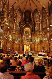 Every day the visitors wait to hear the boy's choir sing in the Basilica de Montserrat.