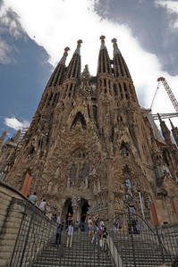 La Sagrada Familia in Barcelona, Spain.  Architecture by Gaudi.  The outside is constantly being worked on as is apparent with the enormous cranes that are next to the building.  This image has the middle crane edited out for a better view of this amazing architectural organic structure.
