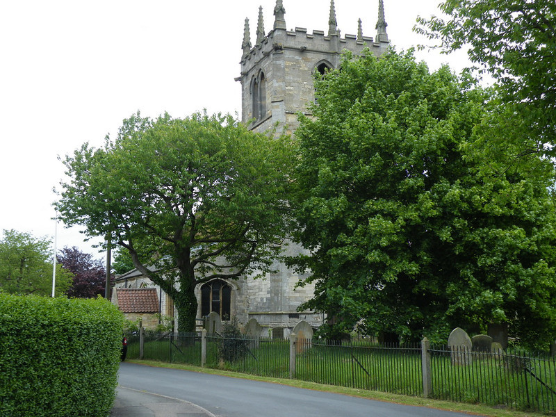 Bardney church seen through the trees in the churchyard.