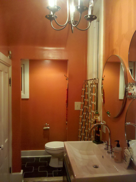 Fun tile, color, and mirror arrangement make this a bathroom door worth keeping open!