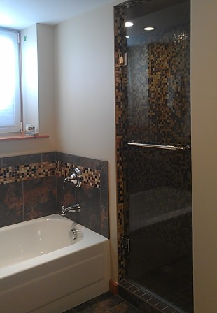 Remodeled Master Bath with rich mosaic walls and accents