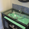 At under $350, this glass counter over espresso wood cabinet is a screaming deal for a remodeled powder bath in Castle Rock.