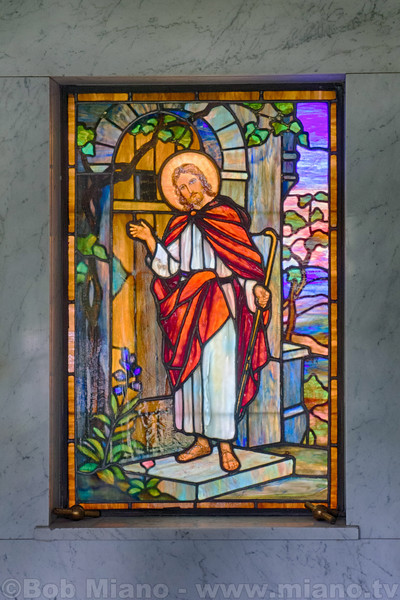 A stained glass window in the mausoleum of Henry W. Gehner.