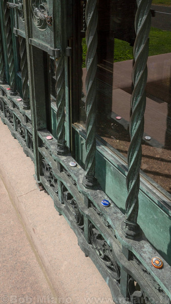 Beer caps left by visitors line the gates of Adolphus Busch's mausoleum at Bellefontaine Cemetery in St. Louis, Missouri.