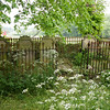 In the churchyard is a very old private burial plot ornately fenced off.