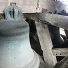 "Up higher, in the bell tower, there is a peal of three bells. These have been ""fixed"" and do not swing as most peals do. They have been modified to that the clappers are now moved by the bell ropes. This means that the bells can be rung by one person."