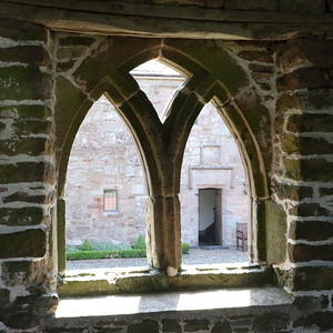 Hall entrance through the arch window