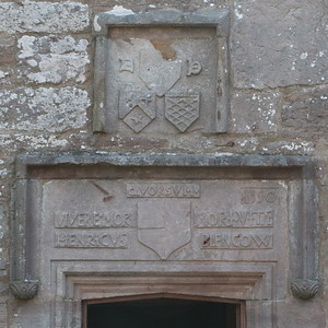 Coat of Arms above courtyard door.