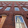 360 new windows are being put in at Boott Mills. (SUN/Julia Malakie)