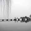 Stone bridge over West Lake, Hangzhou, Zhejiang Province, China by kstellick