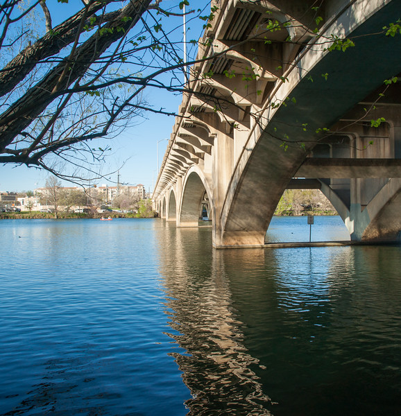 One of the bridges across Lady Bird Lake, leading into downtown Austin.