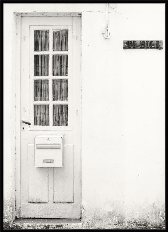 White door in white house