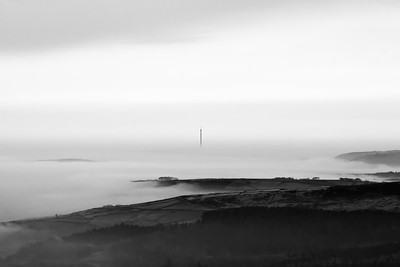 Emley Moor TV Mast viewed from Holme Moss TV mast through the early morning mist