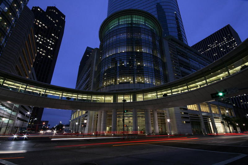 Taken with Sigma 10-20 MM f4.5-5.6 wide angle zoom lens at full wide 10 MM, using Canon Rebel Xti in AV program. Exposure of one second, f13, ISO 400. This is The Allen Center in Houston, facing east into twilight glow.