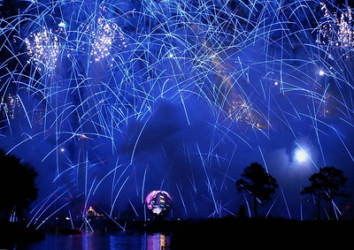 "EPCOT, New Year's Eve, 2005. The loud reports that usually end a fireworks show are numerous super rapid, deafening ""cannon"" type noises in quick sequence, lasting a second or two. This special holiday burst must have gone on for 7 to 10 seconds or more, and stunned the packed crowd into thundering applause."