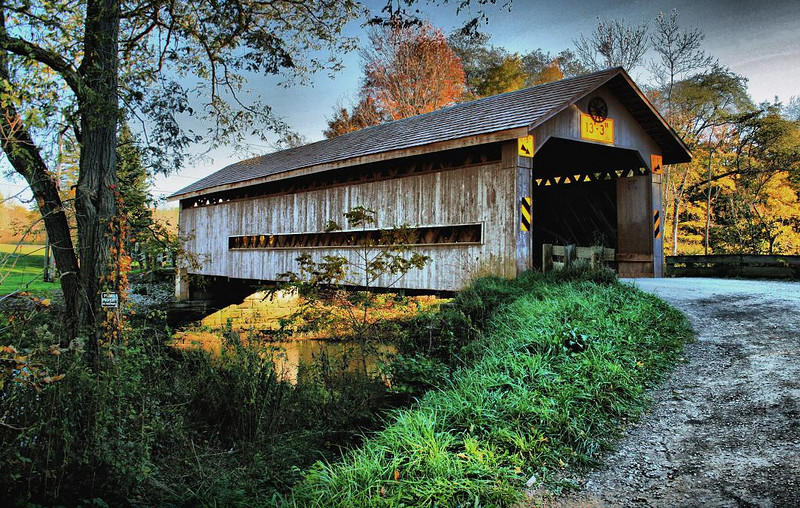 Covered bridge in Northern Ohio. You can tour the Ohio bridges in October using locator maps and enjoy a wonderland of fall colors in the process.
