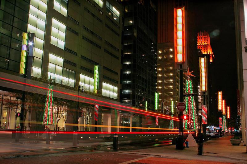 Light rail passes northbound on Main St. at Lamar St., Houston, 12-16-09